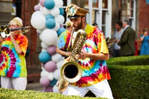 Members of Mr Wilson's Second Liners playing outside the Thackray